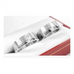 Argollas de Matrimonio en Platino Diseño Plano con un Diamante